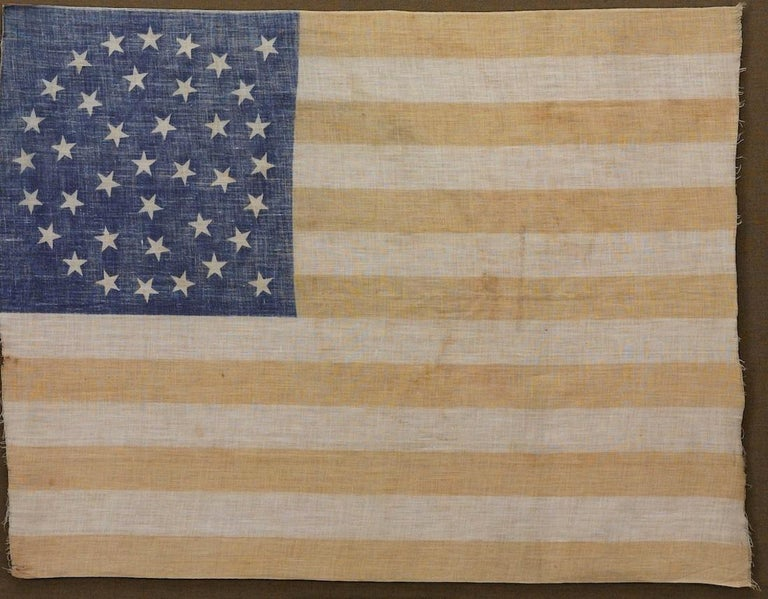Late 19th Century 38-Star Medallion Pattern American Flag with Two Outliers, circa 1876 For Sale