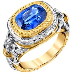 3.80 Carat Blue Sapphire and Diamond, Yellow and White Gold Bezel Set Ring