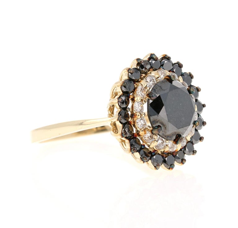 Gorgeous Black Diamond ring that can transform into an Engagement ring.    There is a 2.69 Carat Round Cut Black Diamond in the center on the ring which is surrounded by 14 White Round Cut Diamonds that weigh 0.36 Carats (Clarity: SI, Color: F) and