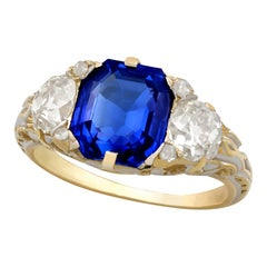 3.80 Carat Sapphire and 1.48 Carat Diamond Yellow and White Gold Trilogy Ring