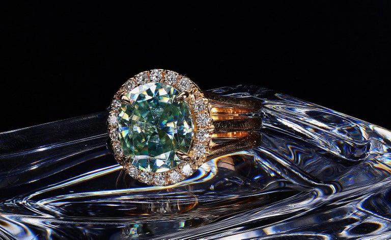 Contemporary 3.81 Carat Oval Fancy Blueish Moissanite & Diamond 18 Karat Golden Cocktail Ring For Sale