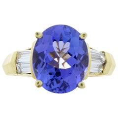 3.81 Carat Oval Tanzanite and Baguette Diamond Yellow Gold Cocktail Ring