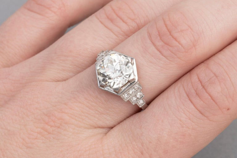 Wonderful Art Deco ring, made in France circa 1930.  The ring is mounted in Platinum handset with a beautiful Round cut Diamond of 3.81 carats. J/K colour and VS clarity. The diamond is very clear. The diamonds shine very well, very good