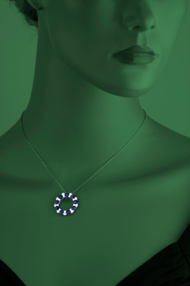 (DiamondTown) This lovely pendant features 9 oval cut dazzling blue sapphires alternating with 9 pairs of round cut diamonds. Total sapphire weight is 3.82 carats. Total diamond weight is 0.87 carats. Pendant is 1