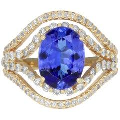 3.82 Carat Oval Natural Tanzanite 1.10 Carat White Diamond Ring 14K Yellow Gold