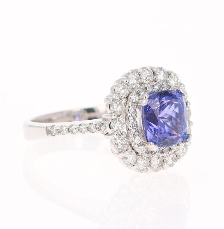 This gorgeous ring has a 2.76 Carat Cushion Cut Tanzanite that is set in the center of the ring. The Tanzanite is surrounded by 2 rows of 47 Round Cut Diamonds that weigh 1.07 carats (Clarity: VS2, Color: F)  The total carat weight of the ring is