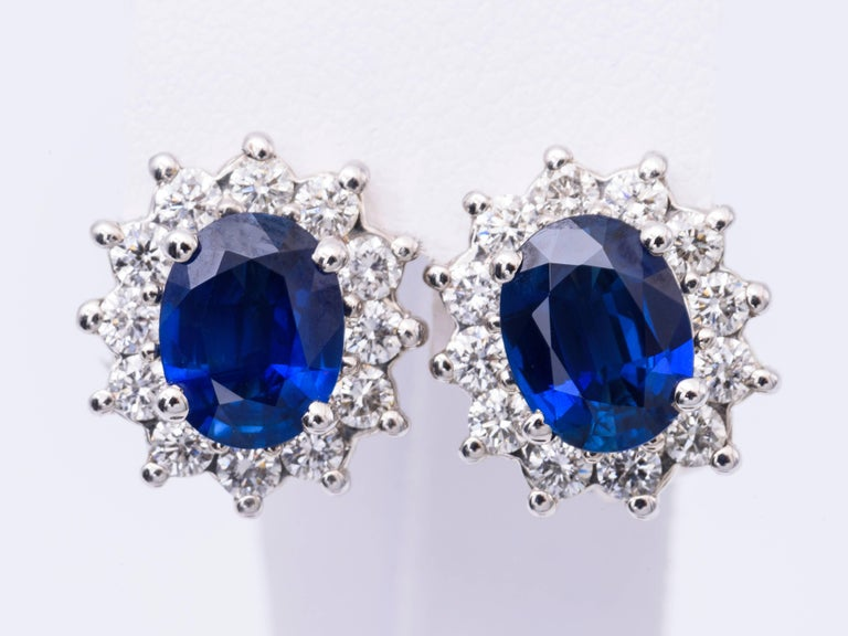 The oval sapphire in these earrings have a total carat weight of 3.84 carats, and they measure 9x7  MM.. The diamonds have a total carat weight of 1.40 carats. The diamonds are H color and clarity is SI2. The sapphire is  very bright and nice. The
