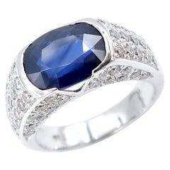 3.85 Carat Velvety Blue Sapphire Pavé Diamond Vacant Sides 18k White Gold Ring