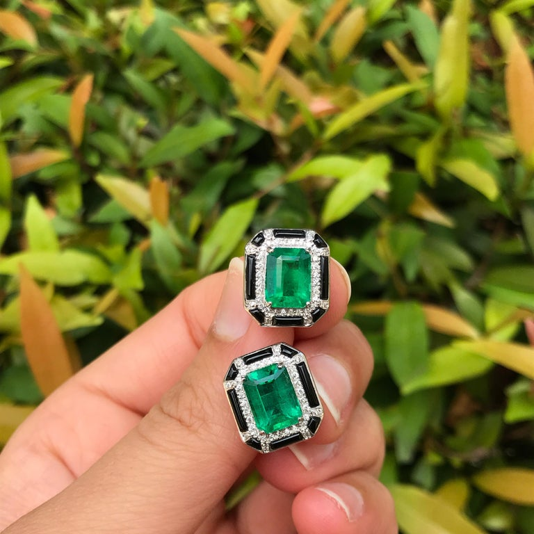 A beautiful pair of art-deco looking 3.85 carat lustrous Zambian Emerald of top quality and color, and Diamond studs with black onyx, all set in 18K White Gold. Push and pull backing included.   Material Details:   Stone: Zambian Emerald  Weight: