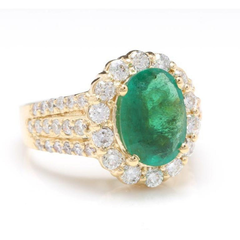 3.88 Carats Natural Emerald and Diamond 14K Solid Yellow Gold Ring  Total Natural Oval Cut Emerald Weight is: Approx. 2.38 Carats (transparent )  Emerald Measures: Approx. 10.00 x 8.00mm  Natural Round Diamonds Weight: Approx. 1.50 Carats (color G-H