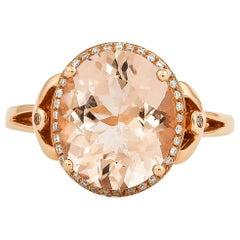 3.92 Carat Oval Shaped Morganite Ring in 18 Karat Rose Gold with Diamonds