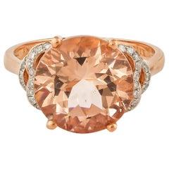 3.92 Carat Round Shaped Morganite Ring in 18 Karat Rose Gold with Diamonds
