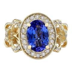 3.93 Carat Natural Tanzanite 18 Karat Yellow Gold Diamond Ring