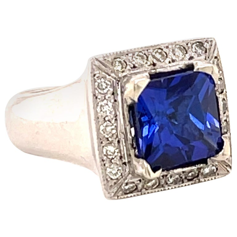 3.93 Carat Tanzanite and Diamond Gold Ring For Sale
