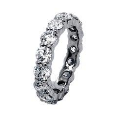 3.94 Carat Share Prong Round Brilliant Diamond 18 Karat Gold Eternity Ring