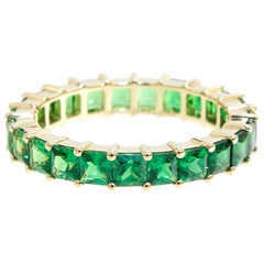 3.95 Carats Square Cut Tsavorite Eternity Band with Fading Color in Yellow Gold