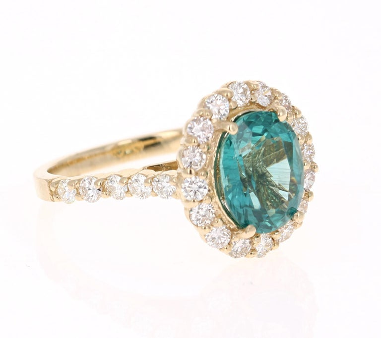 An amazingly deep and beautiful Apatite set in a gorgeous 14 Karat Yellow Gold setting with Diamonds!   Apatites are found in various places around the world including Myanmar, Kenya, India, Brazil, Sri Lanka, Norway, Mexico and the USA. The sea