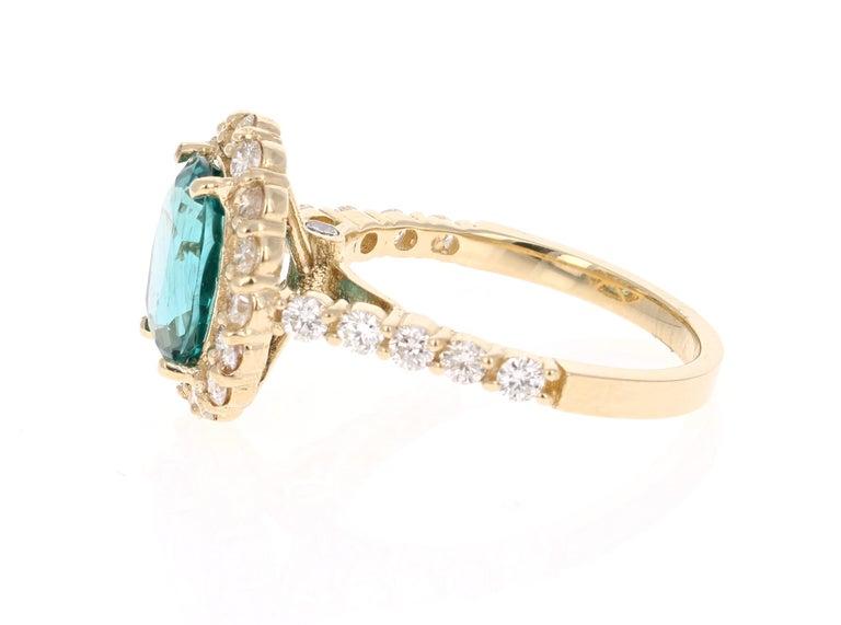 Modern 3.96 Carat Oval Cut Apatite Diamond 14 Karat Yellow Gold Engagement Ring For Sale