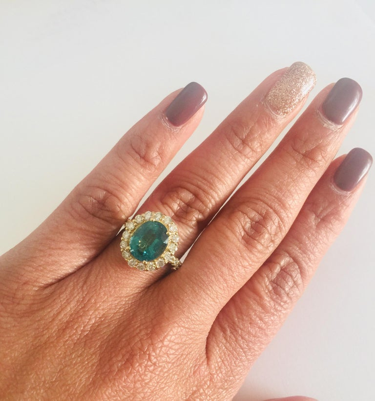 Women's 3.96 Carat Oval Cut Apatite Diamond 14 Karat Yellow Gold Engagement Ring For Sale