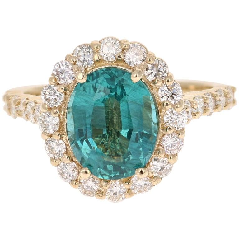 3.96 Carat Oval Cut Apatite Diamond 14 Karat Yellow Gold Engagement Ring For Sale