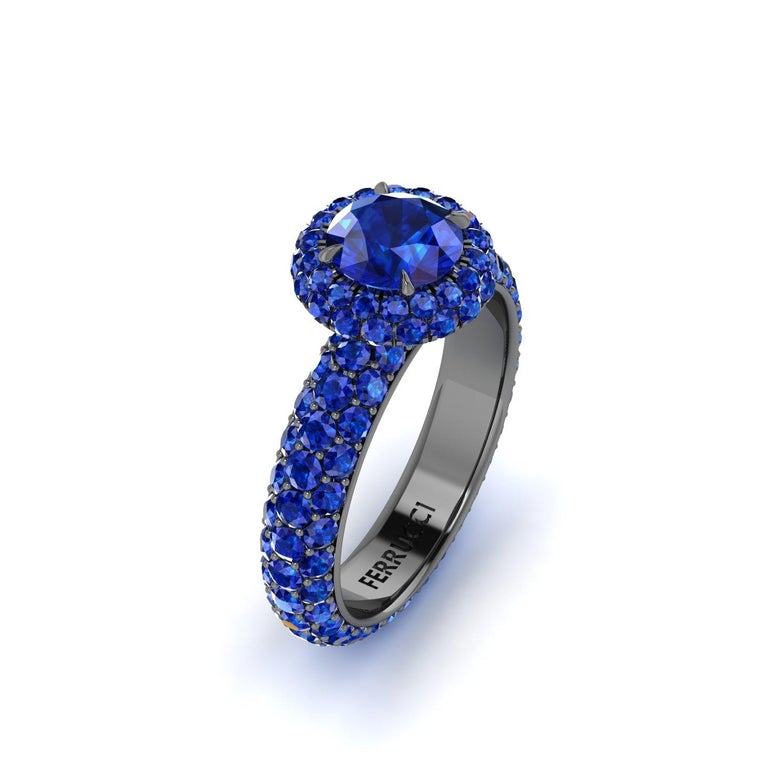 1.16 carat center Round Blue Sapphire set in a Double Round Sapphire Halo and a triple pave' set Sapphire shank eternity style ring, with a total of 132 Sapphires and an approximate total carat weight of 3.96 carats.  Entirely made in New York City