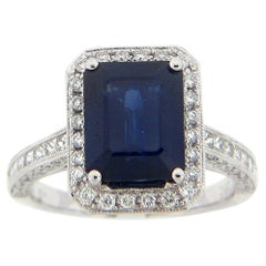 3.97 Carat Emerald Cut Sapphire and Diamond Ring