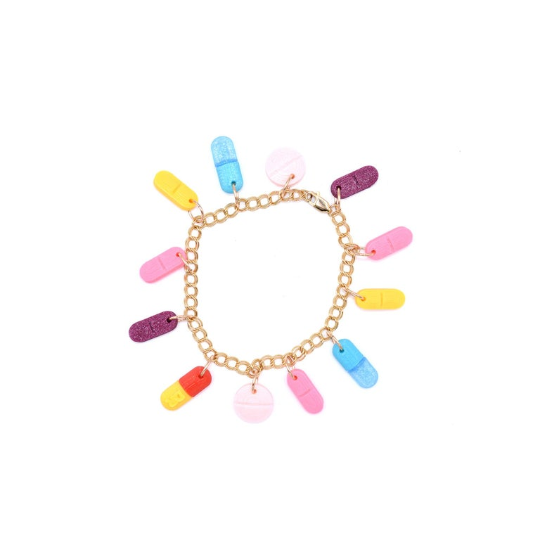 So sexy it hurts! Take 2 tablets twice - daily. These 3d printed pill charms hang from a gold filled bracelet.  Made to order.  Dominique Renée is a 3d printed line of jewelry that sassily explores life, love and loss.