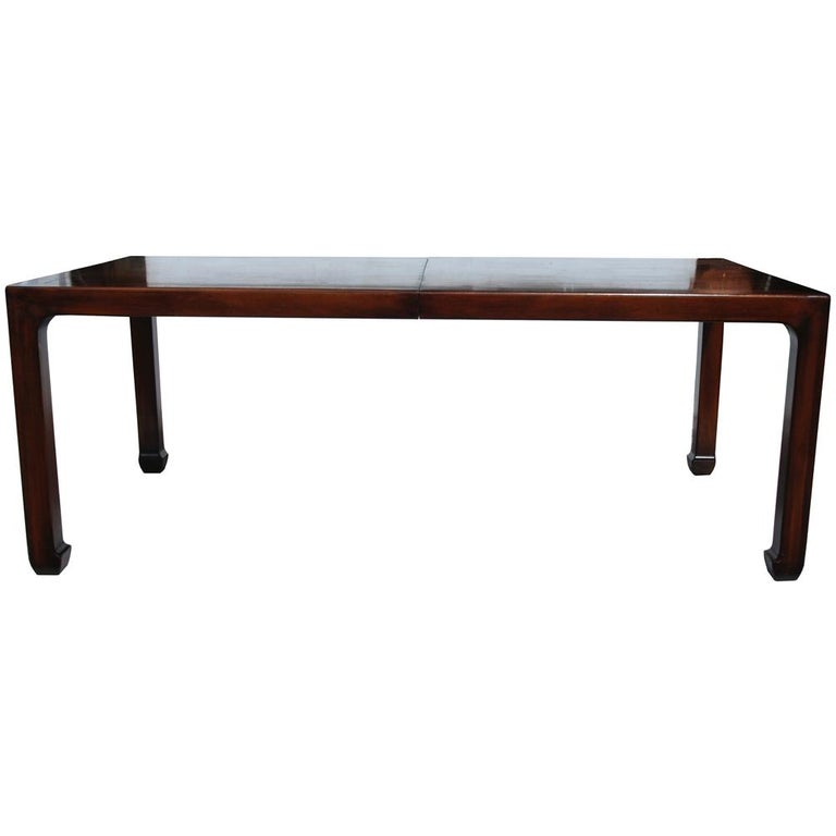 3ft-6.5ft Henredon mahogany extendable dining table with Ming legs.  Manufactured by Henredon, this table features turned in Ming legs, and a rich Mahogany. Has parquey design on top.  Table is extendable, includes two leaves. Each individual
