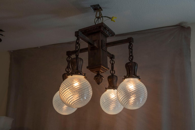 If you need a beautiful chandelier with ceiling limitations, check this one out. It''s all beautiful. A bronze flush mount chandelier with a nice finish, and crisp casting, coupled with 4 hand blown stunning opalescent swirl globes.  Certainly one