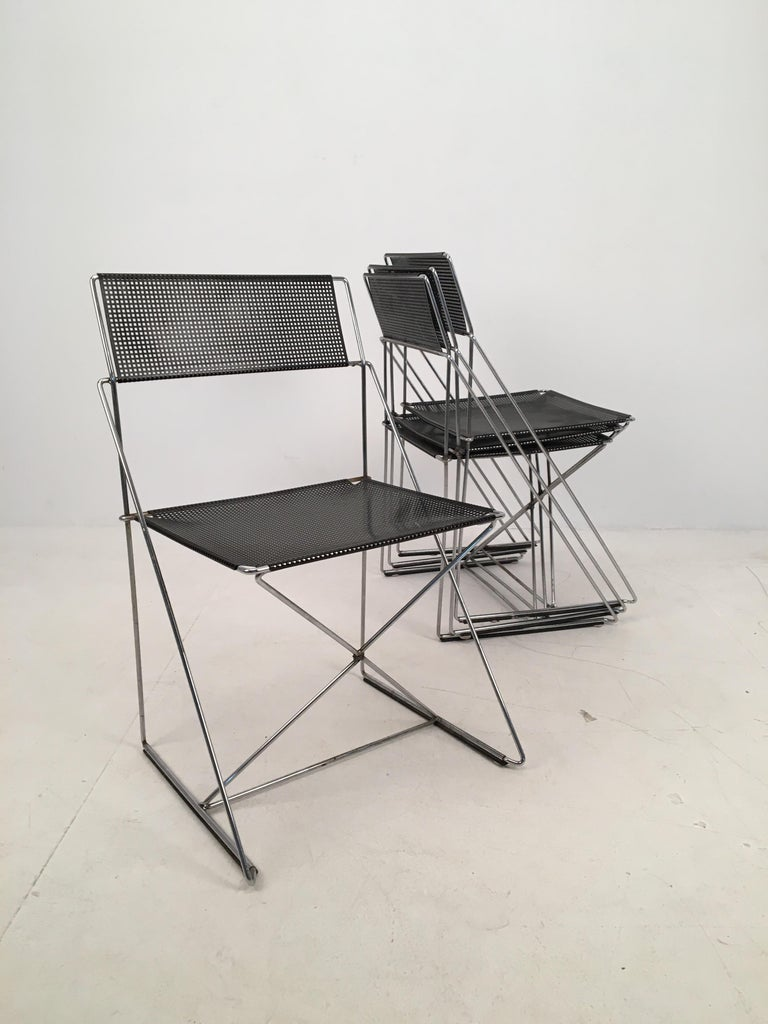Set of 4 Mid-Century Modern 'X-Line' metal stacking chairs designed by Niels Jørgen Haugesen and produced by Hybodan in Copenhagen, Denmark, circa 1970.  Industrial meets Postmodern meet Minimalist, these chairs are very sculptural in appearance