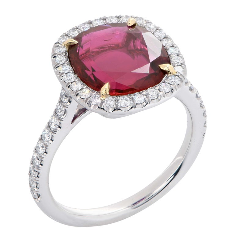 Ruby and diamond ring featuring a 4.04 carat AGL Graded  Cushion Cut Ruby prong set in a platinum ring with 44 round brilliant cut diamonds with a total weight of .46 Cts.  Ring Size: 5.75 (can be sized) Metal: Platinum Metal Weight: 6.5 Grams