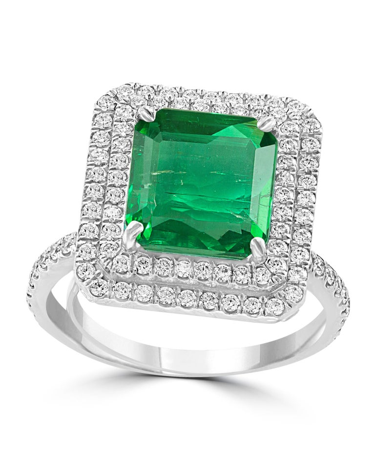 A classic, Cocktail ring  4.0 Carat  Colombian Emerald and Diamond Ring,  with no color enhancement. Platinum 10 gm  Diamonds: approximate 2.3 Carat  Emerald: 4 Carat  Origin : Colombia  Color: Deep  Green, Transparent extreme Fine Color Quality One