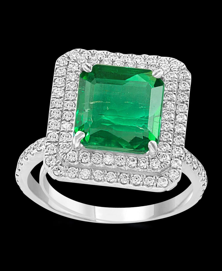 4 Carat Emerald Cut Colombian Emerald and Diamond Platinum Ring Estate In Excellent Condition For Sale In Scarsdale, NY