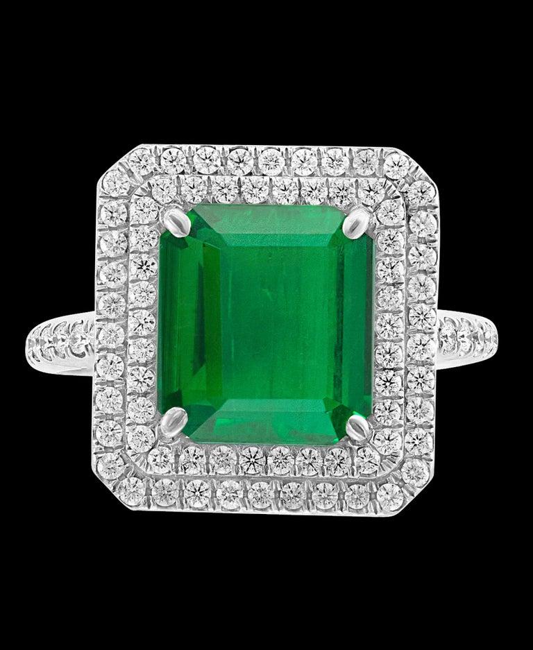 Women's 4 Carat Emerald Cut Colombian Emerald and Diamond Platinum Ring Estate For Sale