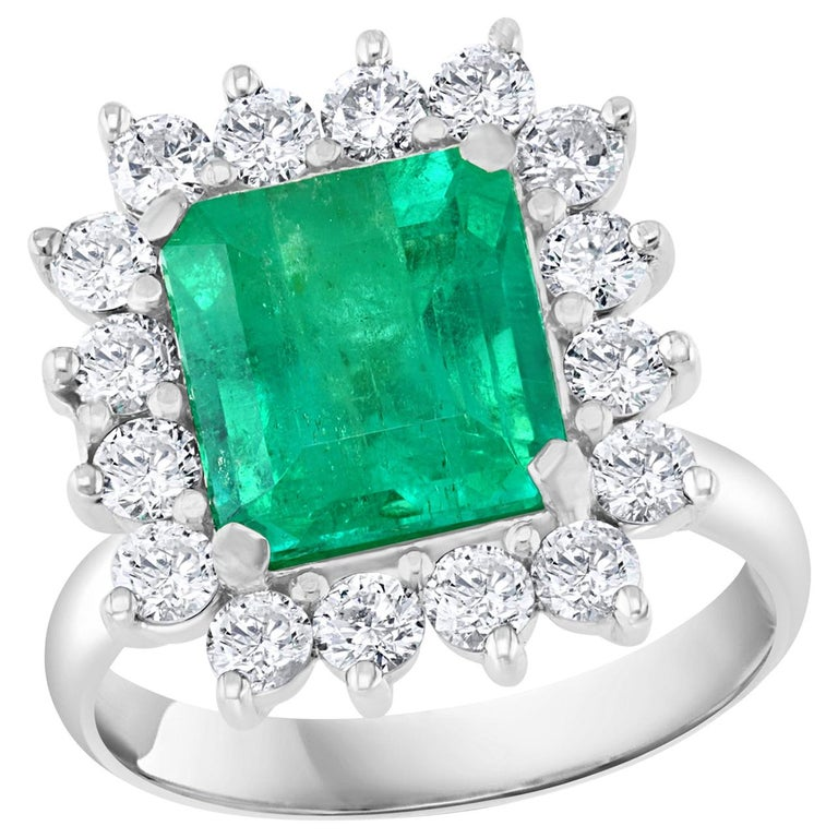 4 Carat Emerald Cut Colombian Emerald and Diamond Ring 14 Karat White Gold For Sale
