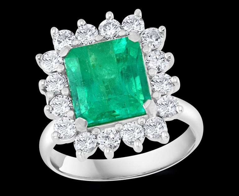 Approximately 4  Carat Emerald Cut Colombian Emerald & Diamond Ring 14 Karat White Gold  A Classic, ring   Absolutely gorgeous emerald , Very desirable color ,  fine quality ,color and luster.  It has inclusions as all natural emeralds do.