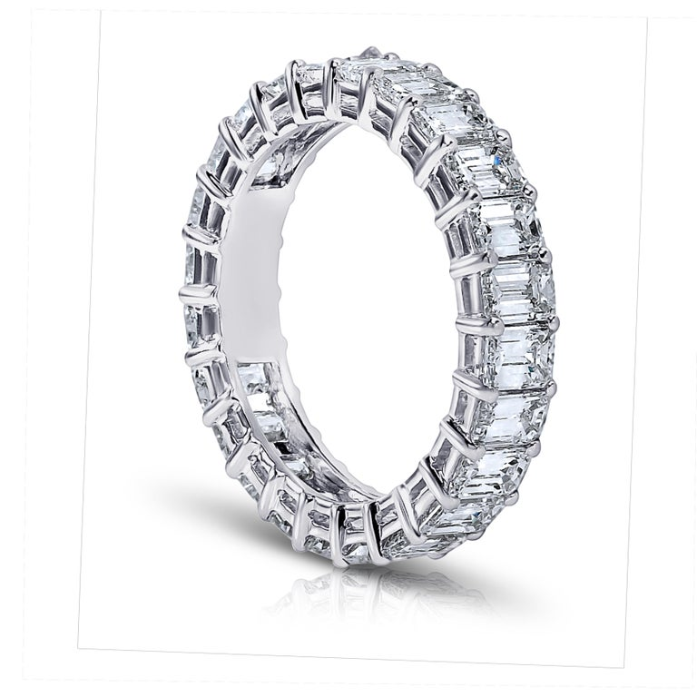 Emerald Cut diamond ring platinum eternity band shared prong style with a gallery. 24 perfectly matched diamonds weighing a minimum of 4.00 cts.   Ranging from G-H in color . VVS1-VS2 in clarity .Finger size 6. Other finger sizes available. Lab