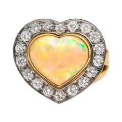 4 Carat Opal Ring with 1.10 Carats of Diamonds