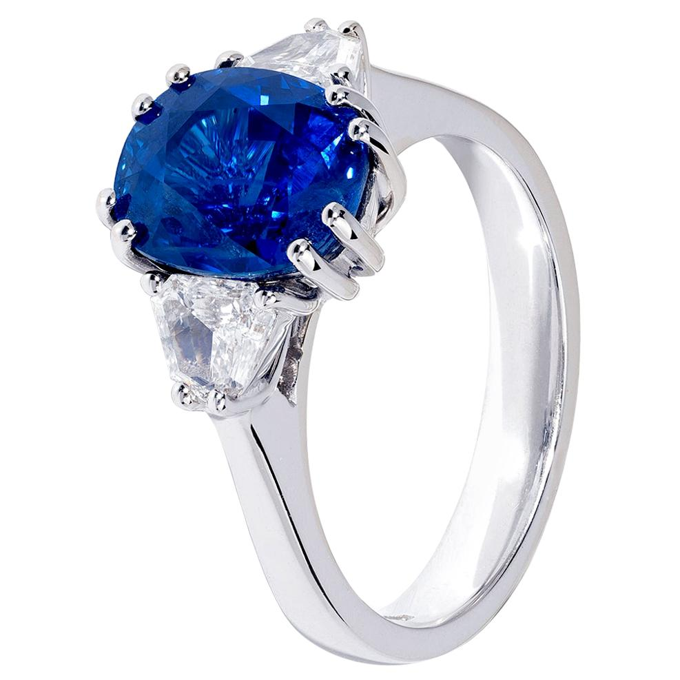 4 Carat Oval Blue Sapphire Three-Stone Ring in White Gold