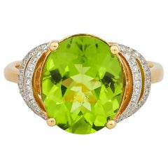 4 Carat Peridot and Diamond Ring in 18 Karat Yellow Gold
