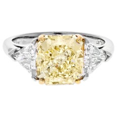 4 Carat Radiant Cut Diamond Fancy Yellow GIA Three-Stone Engagement Ring