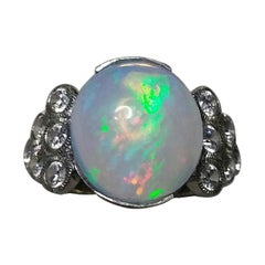 4 Carats Opal Oval Cabochon 14 Kt Gold 12 Full Cut Round Diamonds Cocktail Ring