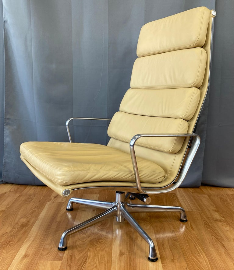 Part of the Eames Aluminum Group, for Herman Miller. It's the 4 back cushion model in leather, with the color like desert sand.