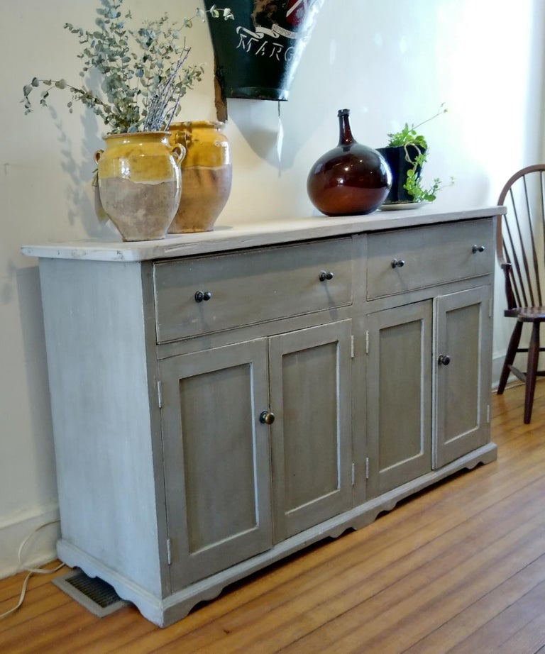 - It's the old brass knobs and light pickled top that get your attention on this functional dresser base. Just the right size not to too large and plenty of storage and shelf underneath. The color is a very soft grey/green.
