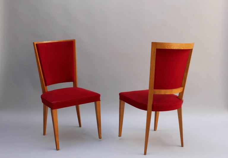 Four French 1940s solid oak dining chairs.