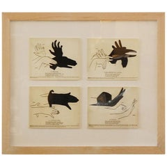 4 images of shadow puppets framed.