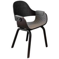 4 leg chair in ash stained black and upholstered in fabric
