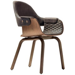 4 leg chair in walnut, upholstered in leather by Jaime Hayon