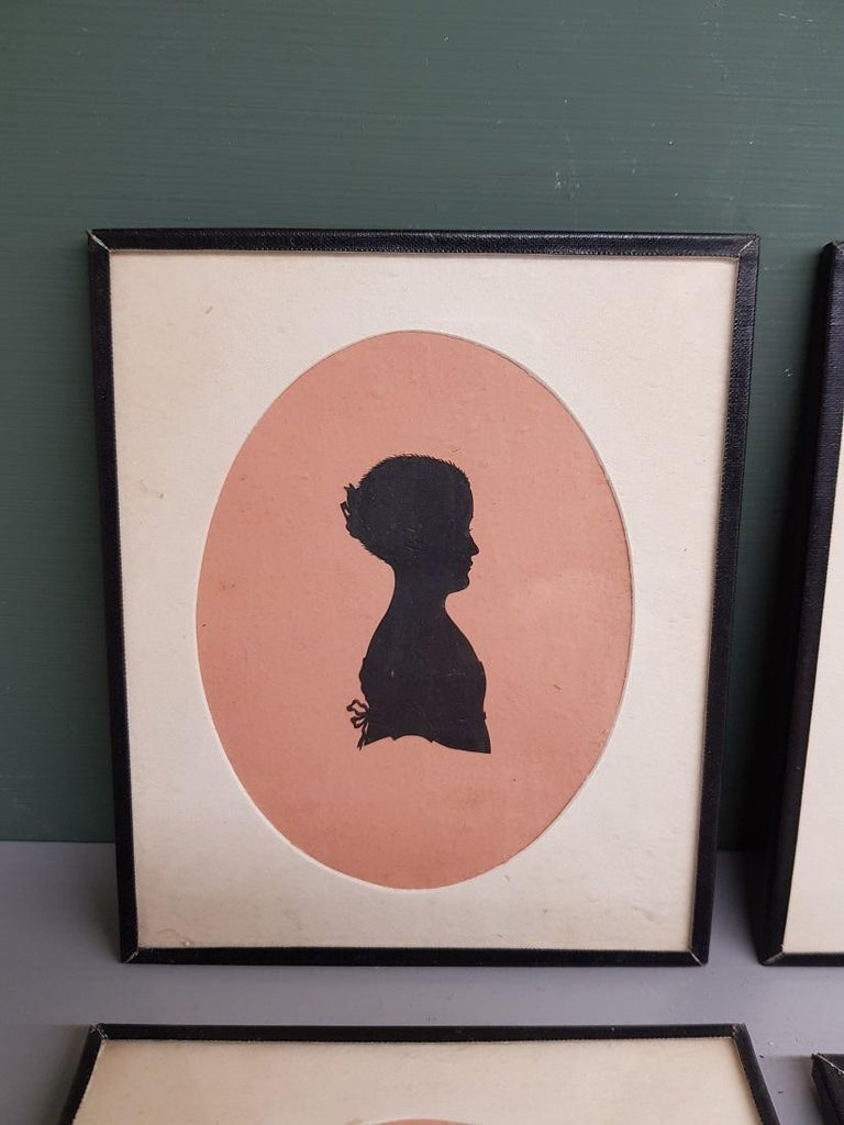 Set of 4 antique miniature silhouettes made of cut out black paper that is inscribed with pencil and on the back probably the description of who it concerns, all are in good condition. Originating from the mid-19th century.  The measurements