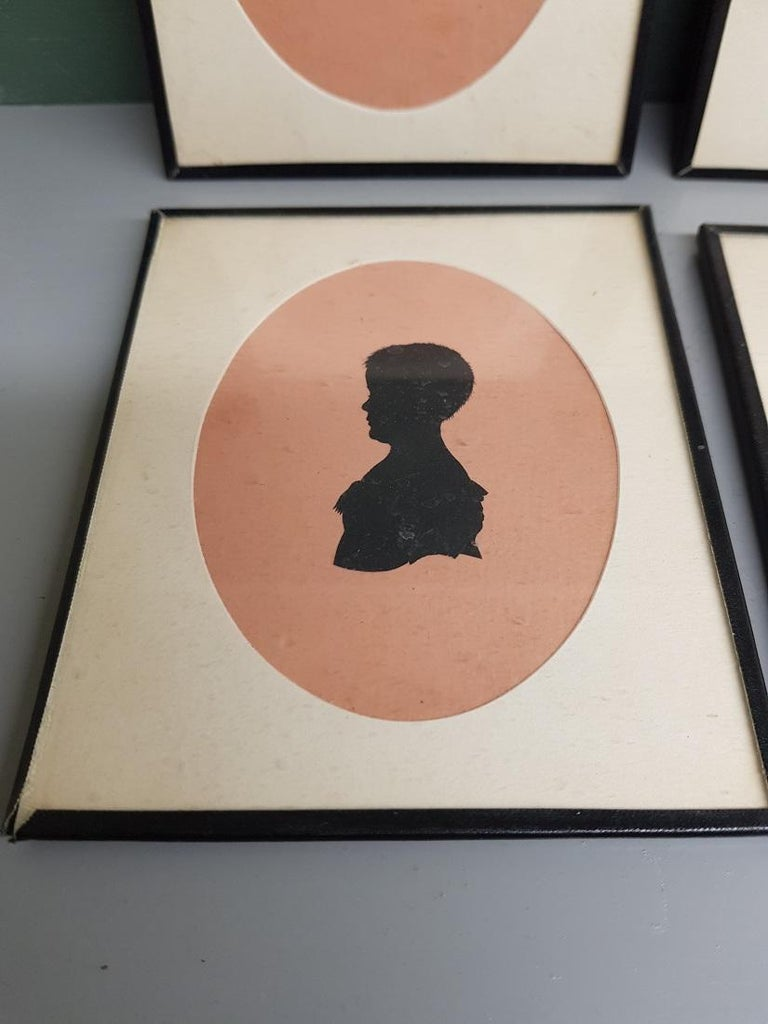 Hand-Crafted 4 Mid-19th Century Miniature Silhouettes of Probably a Mother with Daughters For Sale